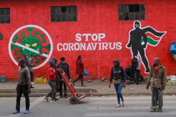 Kenyans walk past a mural about the coronavirus, Haile Selassie Avenue, Nairobi. Press Association.jpg