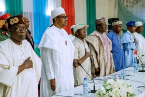 President Buhari, second from left at the inauguration of his campaign council