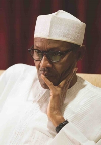 Buhari appears sombre